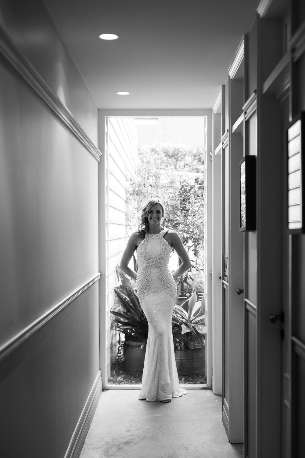 Smiling bride in a window. Black and white photo of bride. Chiswick restaurant wedding.