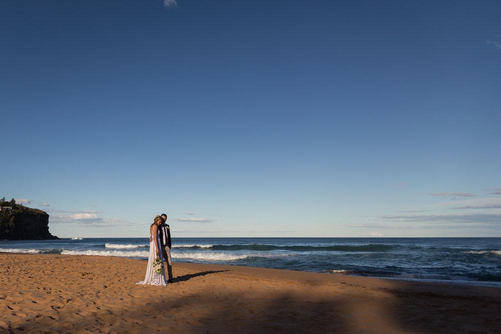 Bride and groom on the beach. Bilgola Beach wedding.