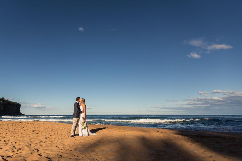 Bilgola Beach Wedding. Bride and Groom photo on Beach. Relaxed, natural wedding photography Sydney.