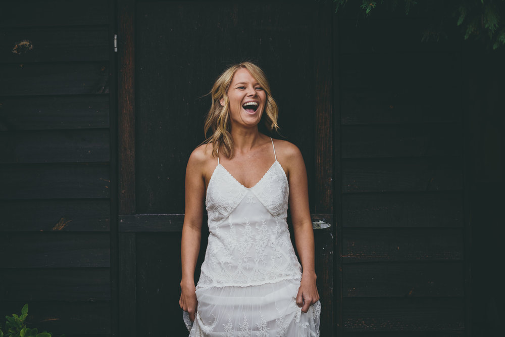 Laughing bride in wedding dress. Natural, relaxed wedding photography. Sydney Wedding photography.