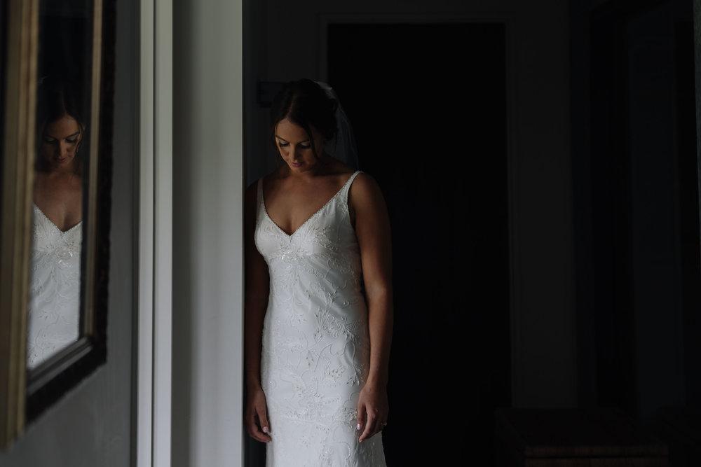 Bride in doorway photo. Natural light, wedding photography. Coromandel coast wedding