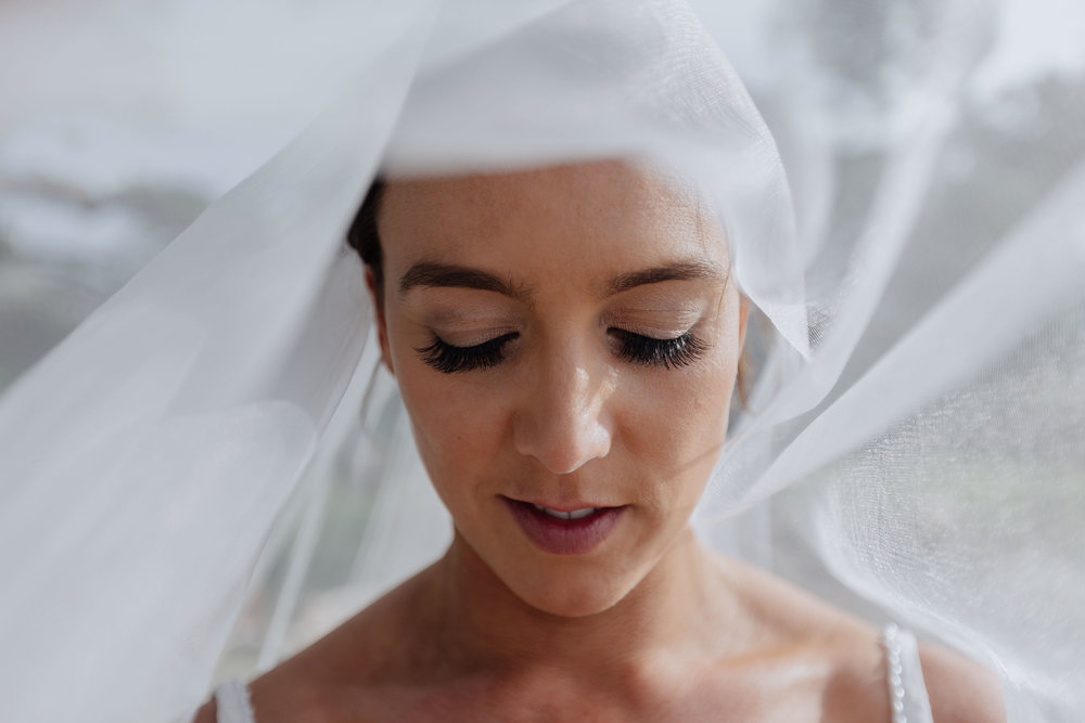 Beautiful bride with veil photo. Natural, relaxed wedding photography.