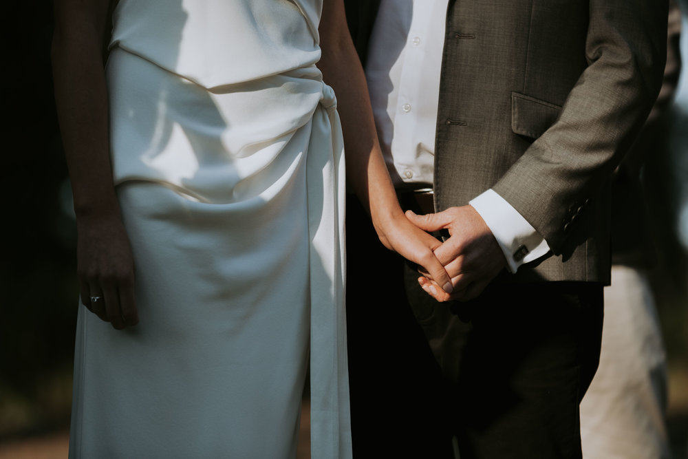 Bride and groom holding hands. Natural, relaxed wedding photography. Sydney photographer
