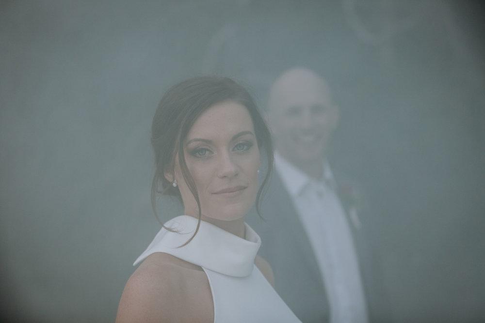 Bride and groom smoke bomb photo. Ripples Chowder Bay wedding.