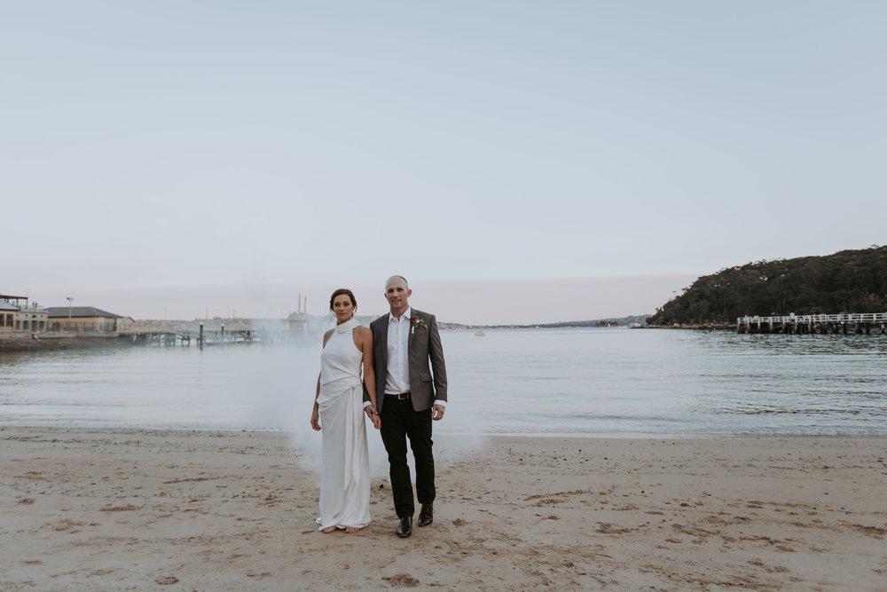 Bride and groom at chowder bay. Smoke bomb photo. Ripples Chowder Bay wedding.