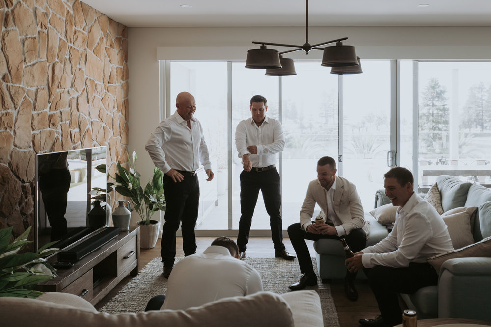 Groomsmen getting ready. Relaxed South Coast wedding photography