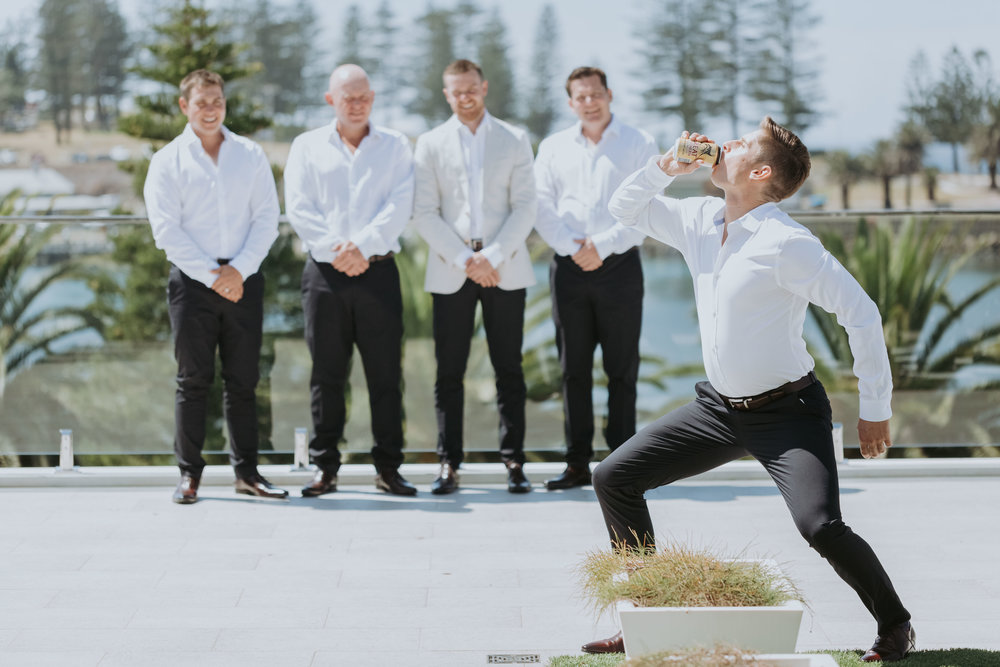 Groomsmen preparations. Candid wedding photography. South Coast wedding.