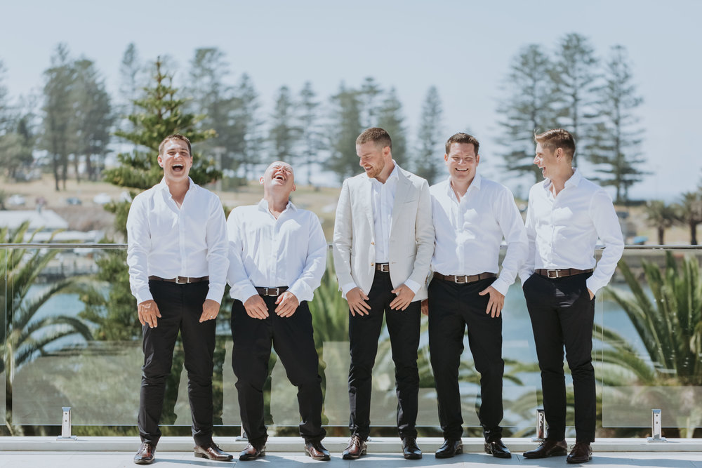 Groomsmen and groom laughing photo. South Coast wedding photography