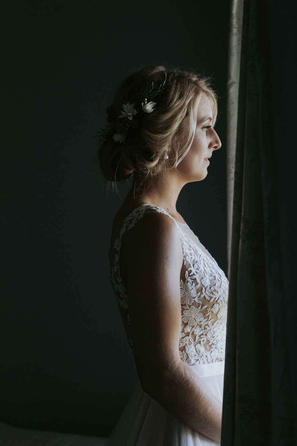 Bride in window photo. Candid wedding photography on the South Coast