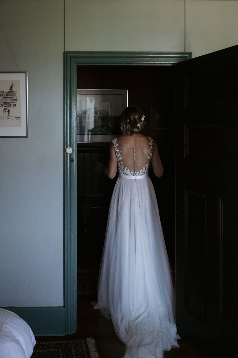 Bride in dress in doorway photo. Natural wedding photography