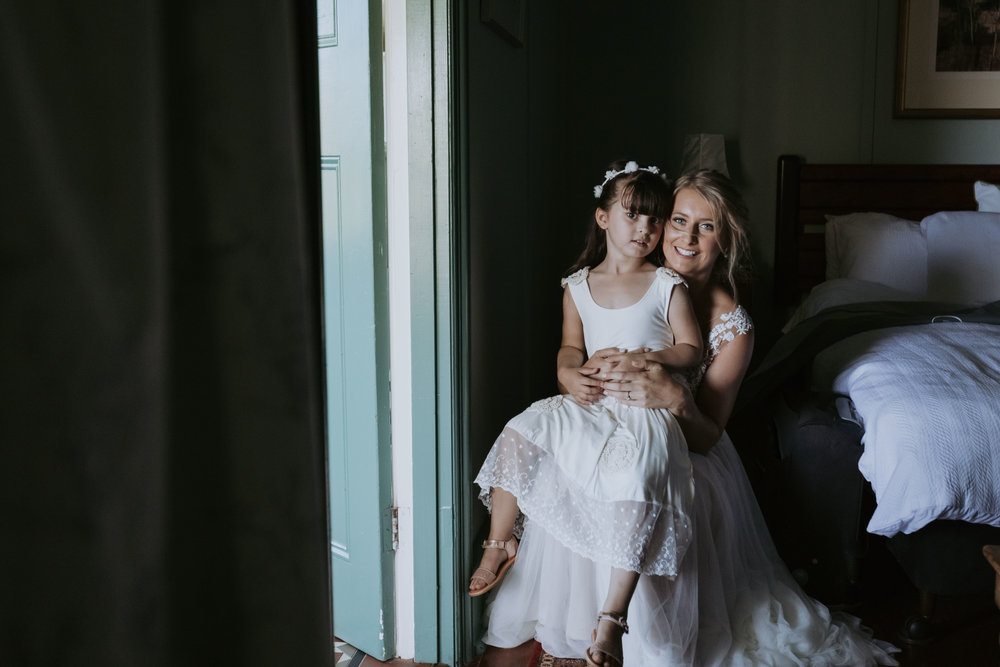 Bride with flower girl. Natural, relaxed wedding photography Kiama