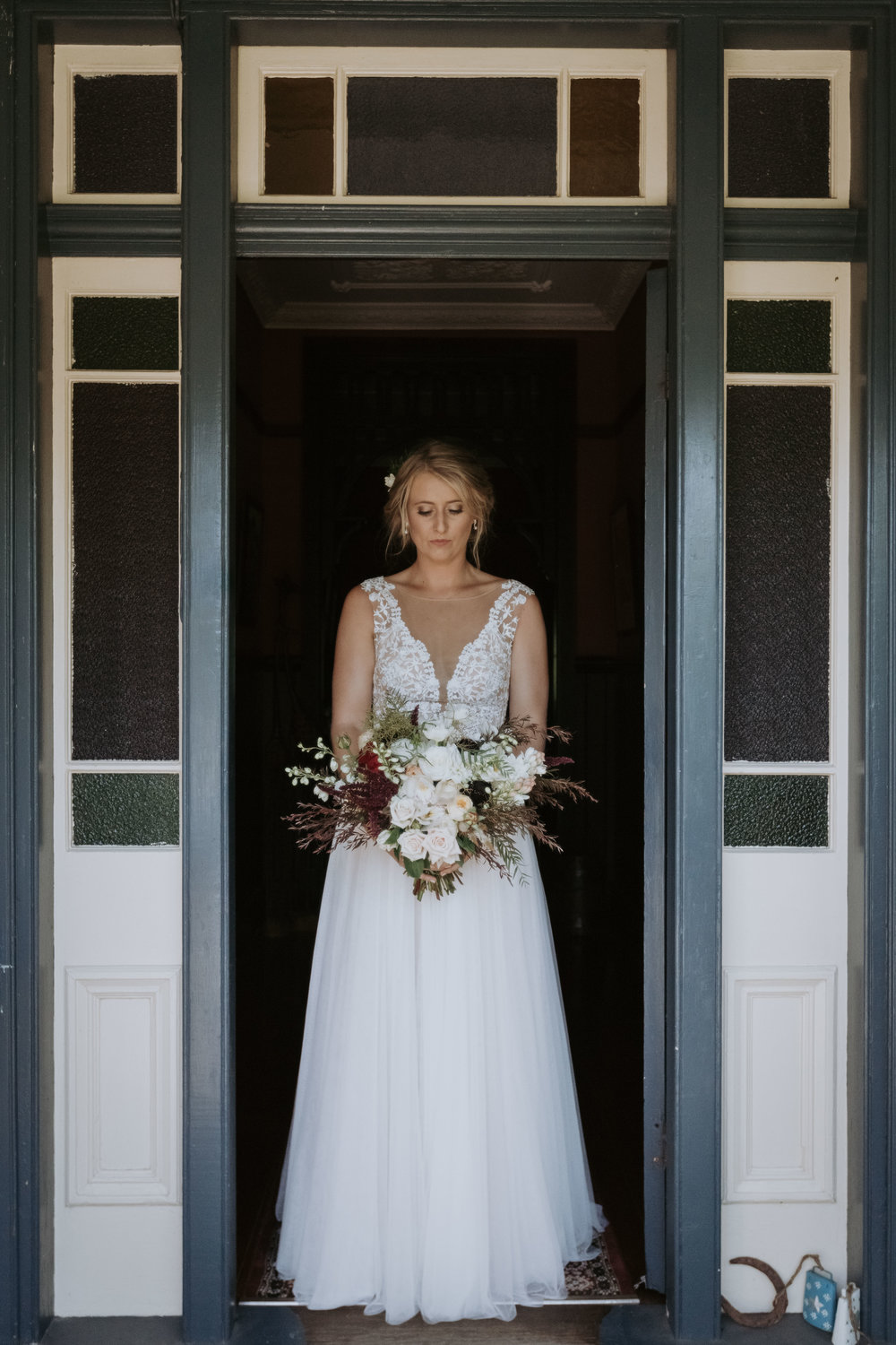 Bride in doorway photo. Natural south coast wedding photography