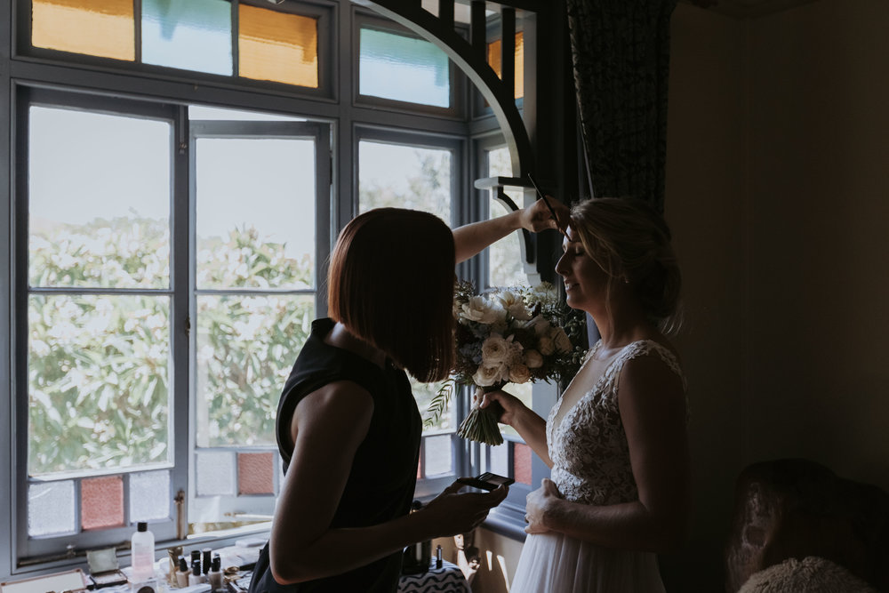 Bride getting make up on. Natural, relaxed wedding photography Kiama