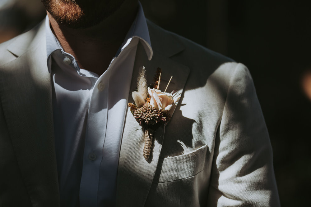 Grooms lapel floral photo. South Coast wedding photography