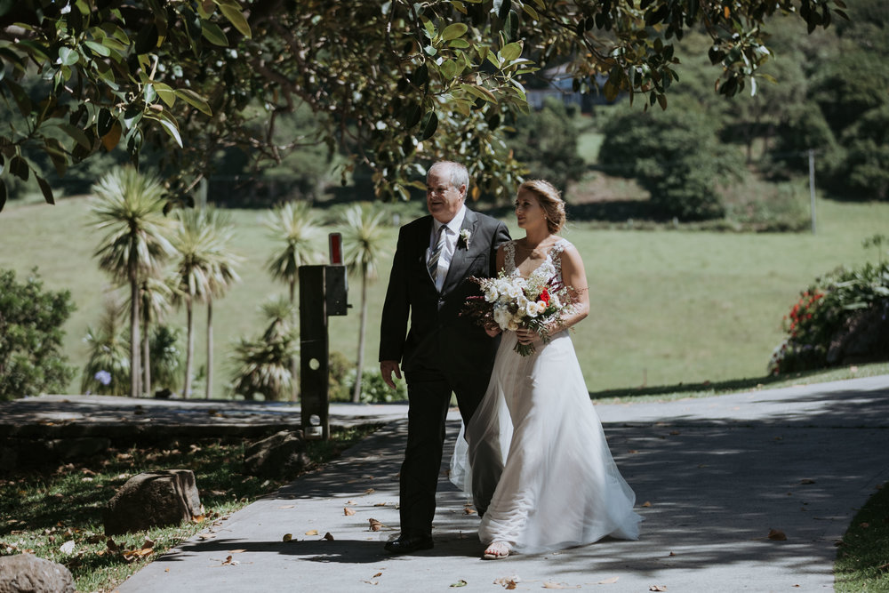 Bride and her father walking down the aisle. Bush Bank Weddings Kiama.