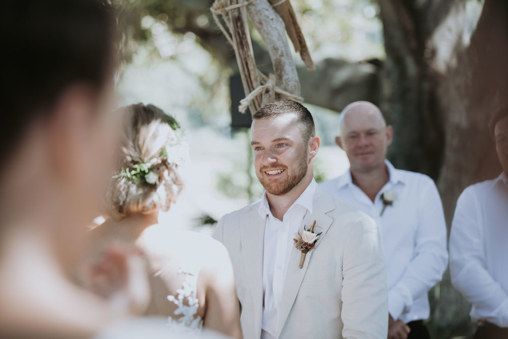 Groom smiling at bride photo. South Coast Wedding Photography