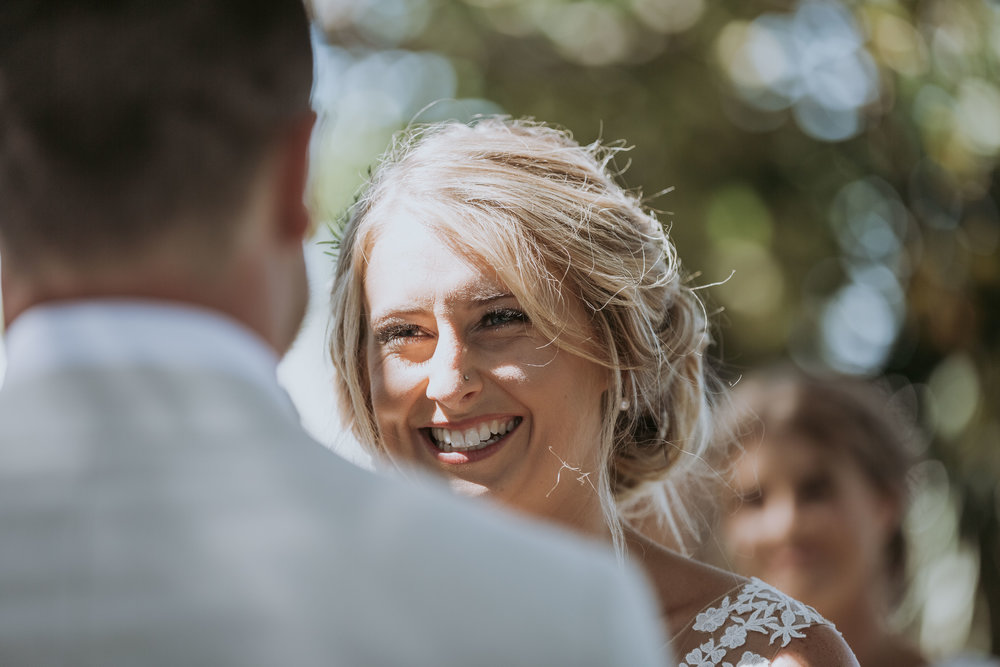 Bride smiling at groom photo. Natural, relaxed wedding photography Kiama