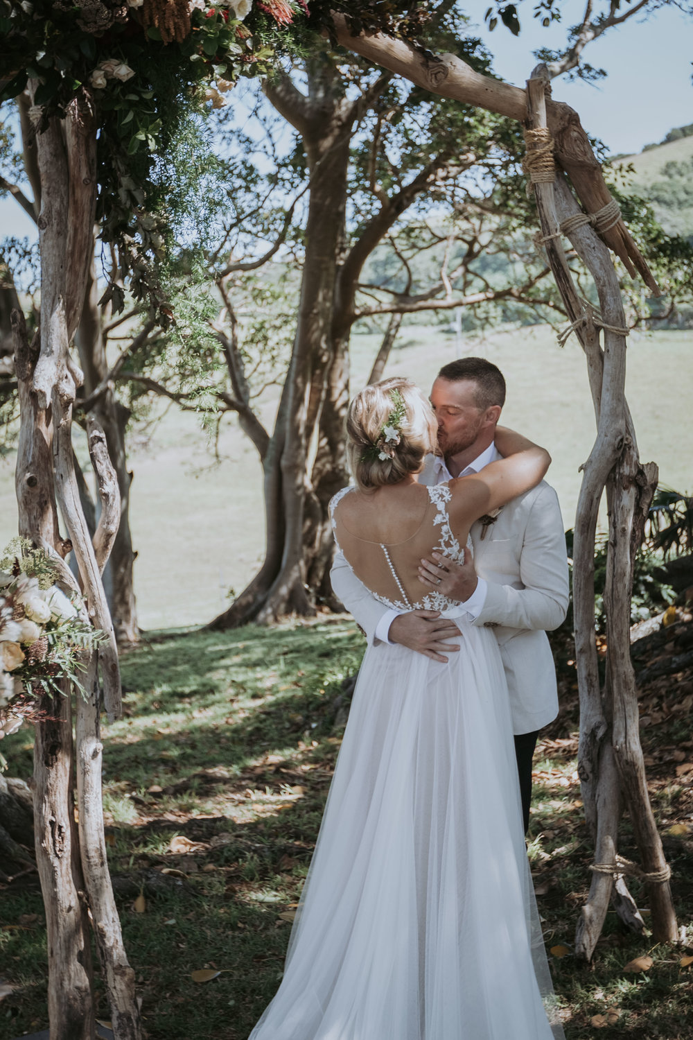 Bride and Groom first kiss photo. Bush Bank Weddings Kiama