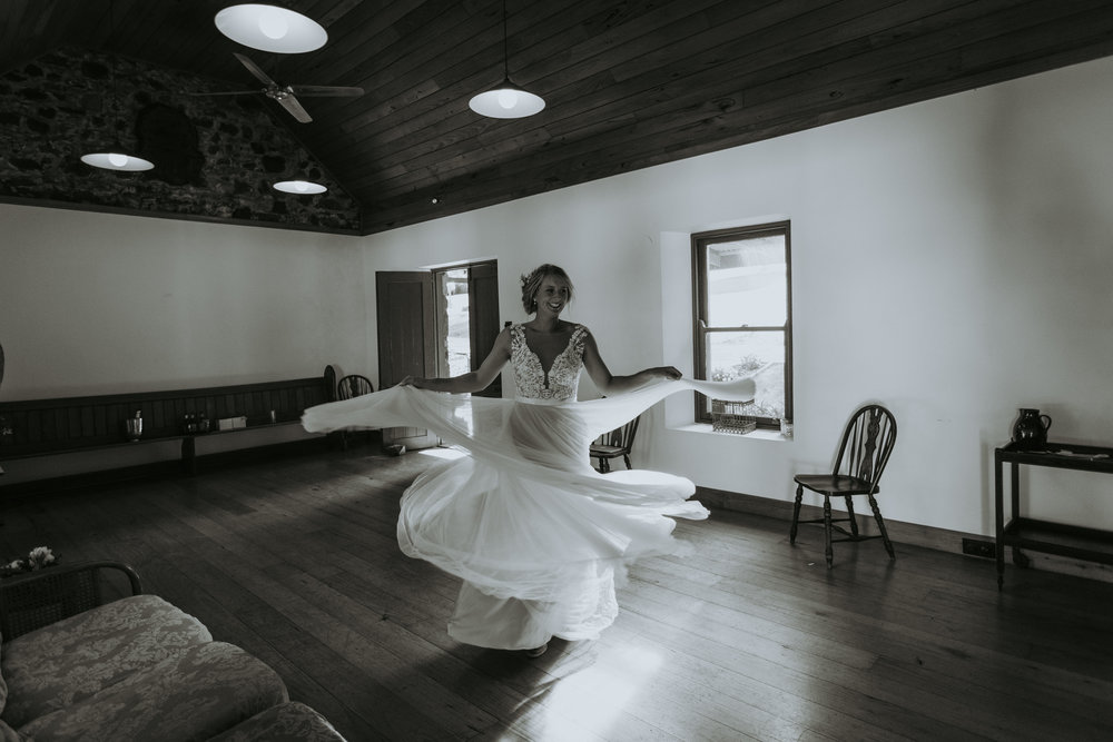 Bride twirling in dress photo. Candid wedding photography. South coast wedding.