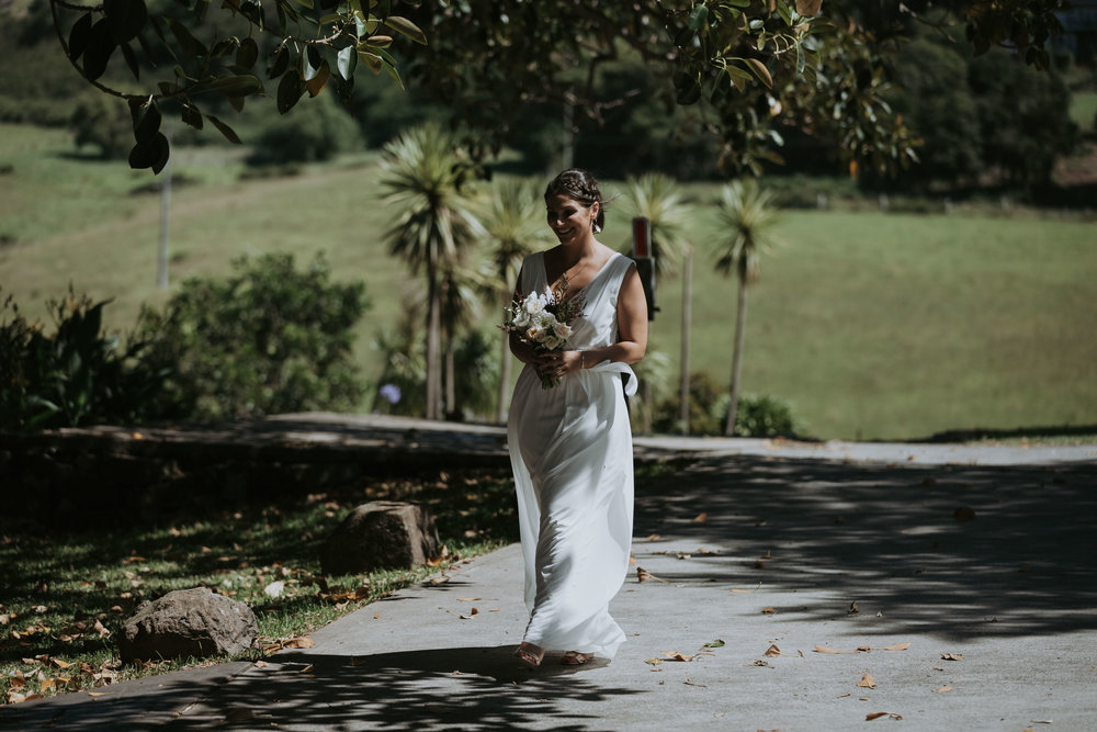 Bridesmaid walking down aisle photo. Candid wedding photography. South coast Wedding