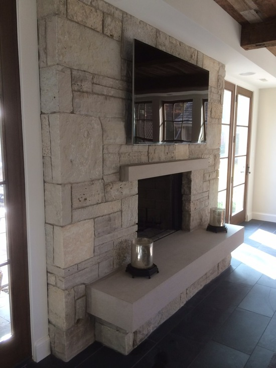 indoor fireplace with tv mounted above