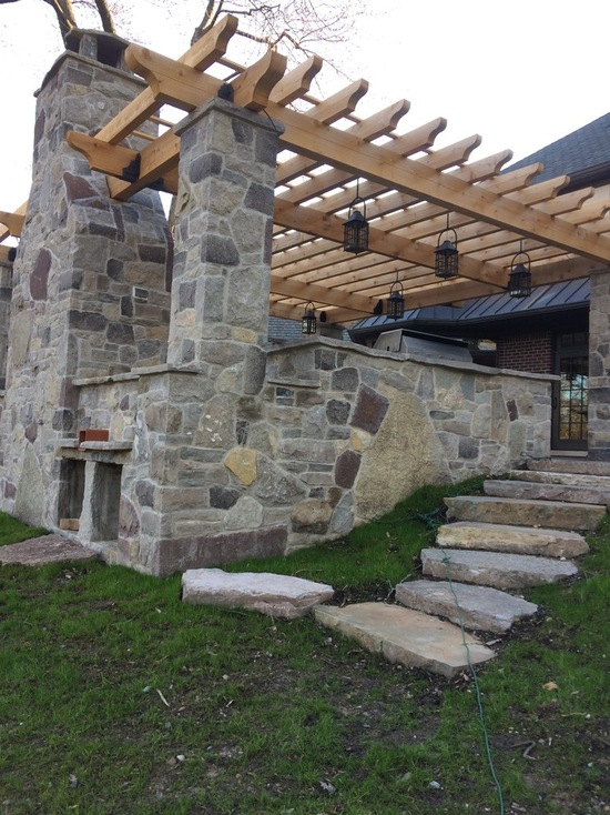 natural stone and custom wood working pergola structure