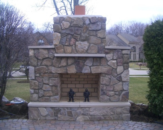 outdoor fireplace with chimney and mantle