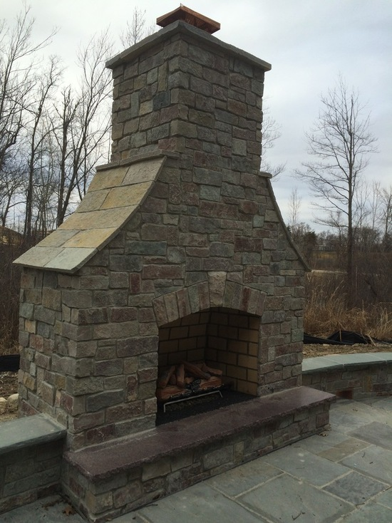 fireplace with slanted top in the backyard