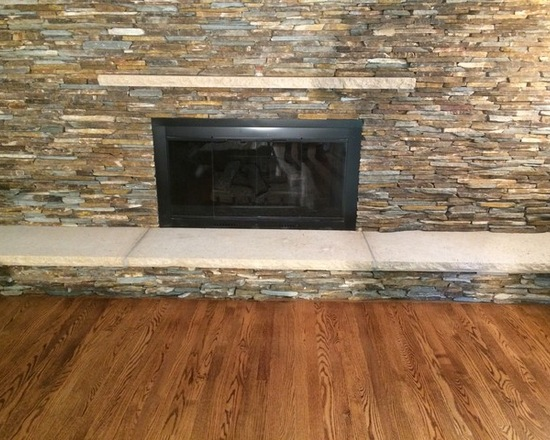 Fireplace on large wall indoors
