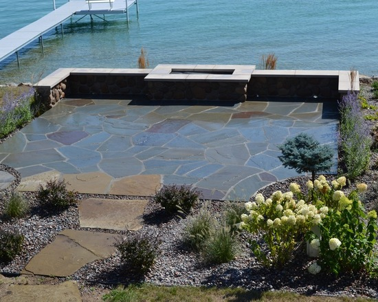 lake house backyard with a bluestone patio