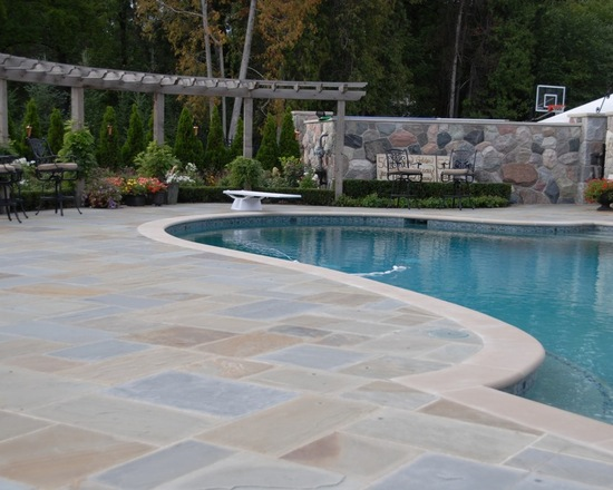 custom stone work pool and terrace