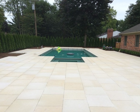 Large pool deck with natural stone