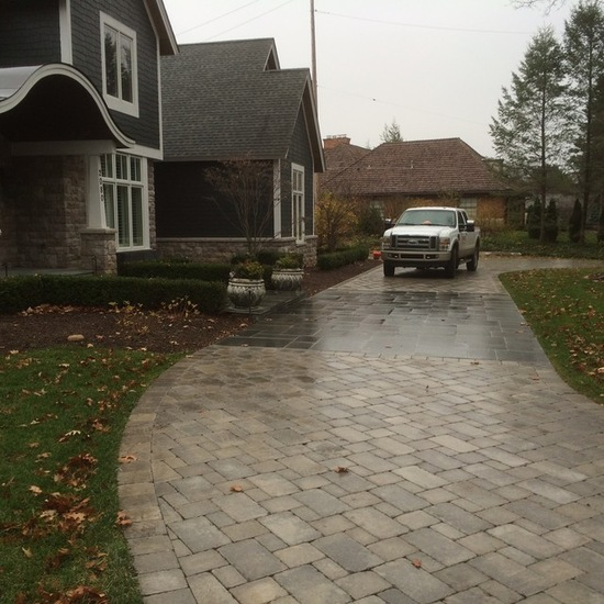 Car in brick driveway in autumn