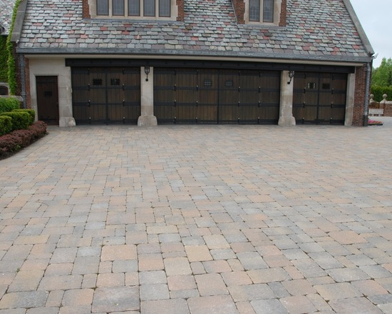four car garage and brick driveway