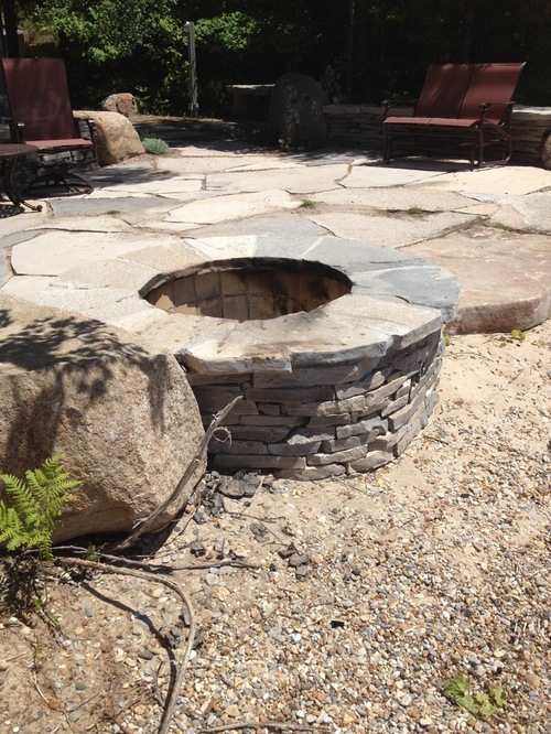 Natural stone firepit on gravel