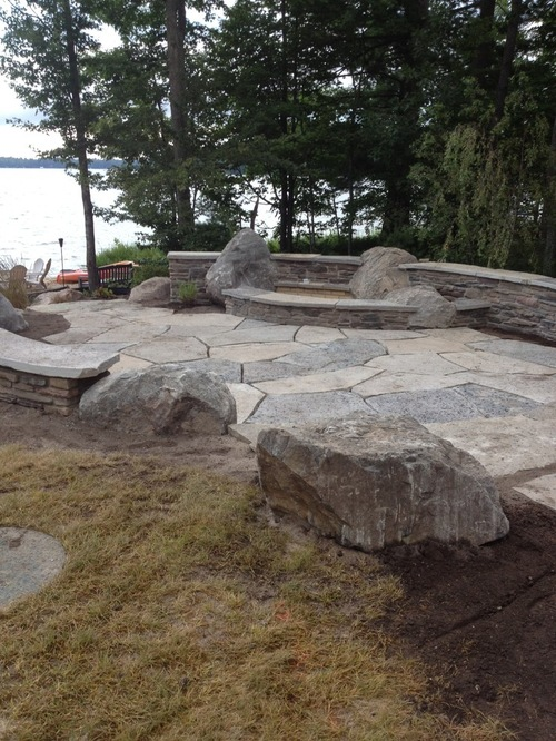 Construction of square firepit in backyard