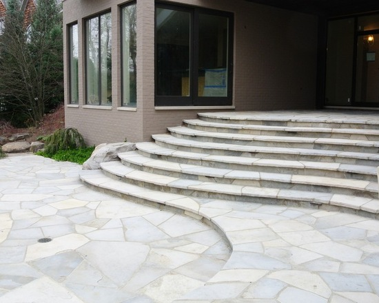 smooth stone steps in front of a house front door