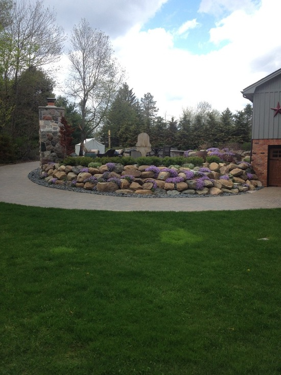 stone wall around island in driveway