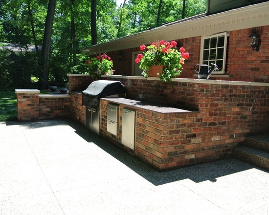 outdoor brick kitchen with potted plants