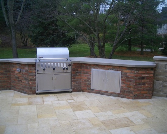 stainless steel outdoor kitchen with brick