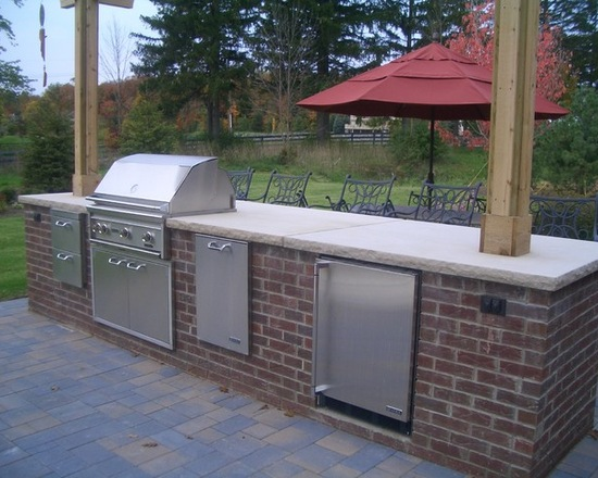 stainless steel kitchen bar with red umbrella