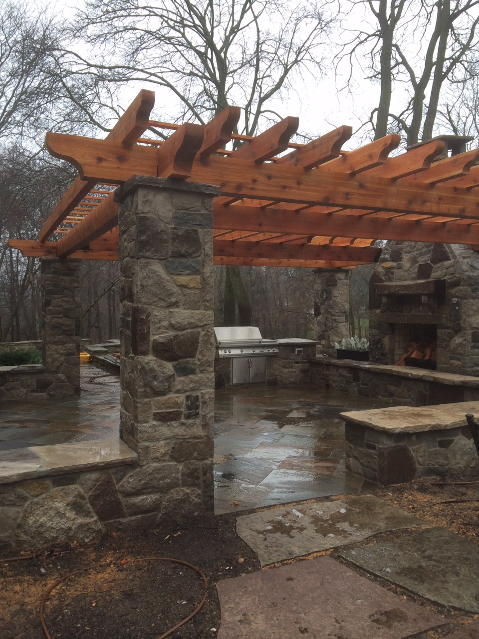 Wooden pergola and natural stone columns