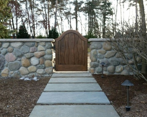 Wooden Gate and Natural Stone Wall