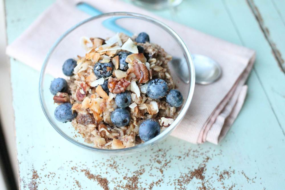 Topped with toasted pecans, coconut flakes, blueberries and honey