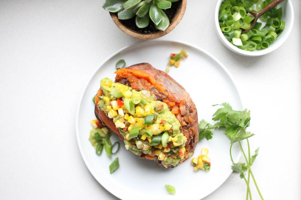 Baked Sweet Potatoes  Stuffed with Black Bean Chili topped with  Grilled Corn Salsa