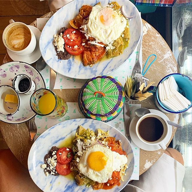 Chilaquiles @maisonbelen while my leg touches a glass display of pastries