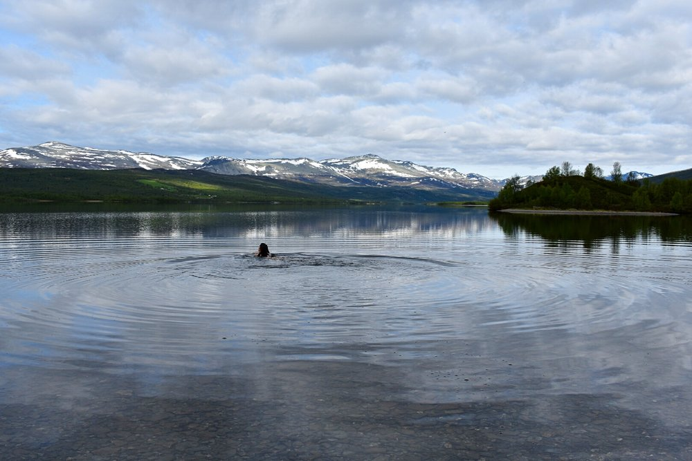 Our volunteer, Rike, going for an early morning, bracing swim in the Storfjorden lake.