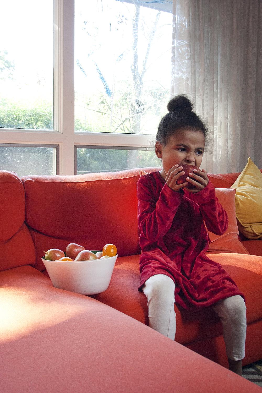 Emerald Amira Eats Apple.jpg