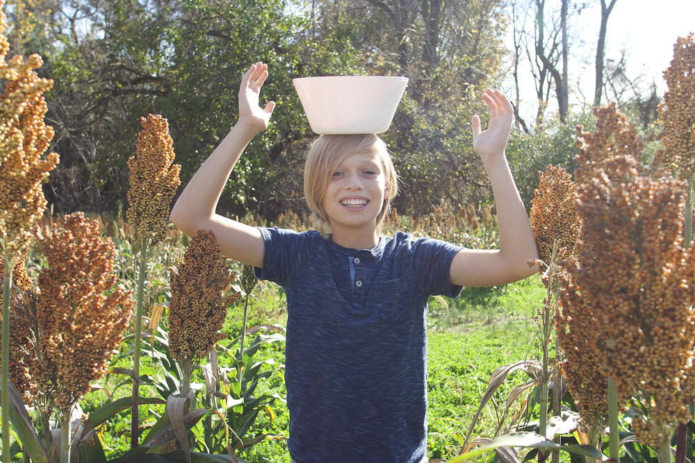 Liam balances bowl on head.jpg