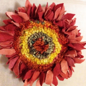hooked prodded sunflower pin.jpg